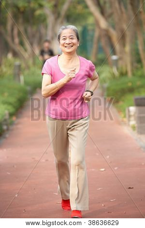 Senior Chinese Woman Jogging In Park