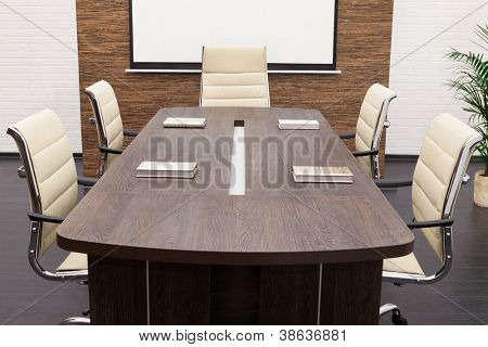 table for negotiations with the screen in the office