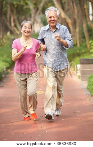Senior Chinese Couple Jogging In Park