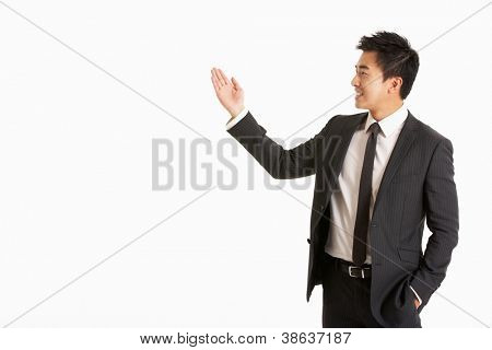 Studio Portrait Of Chinese Businessman Gesturing