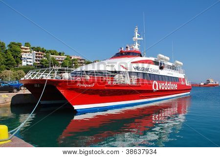 ALONISSOS, GREECE - SEPTEMBER 27: Hellenic Seaways catamaran ferry Flying Cat 5 moored at Patitiri harbour on September 27, 2012 at Alonissos island, Greece. The catamaran was built in Norway in 1996.