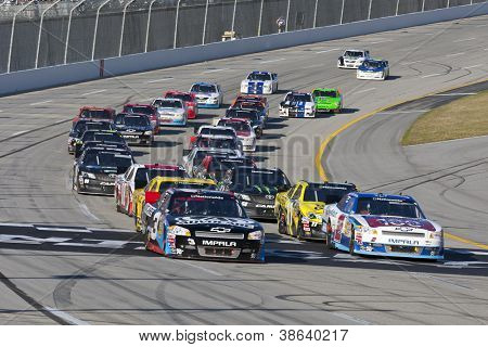 SPARTA, KY - SEP 22, 2012:  The NASCAR Nationwide Series teams take to the track for the Kentucky 300 at the Kentucky Speedway in Sparta, KY on Sept 22, 2012.