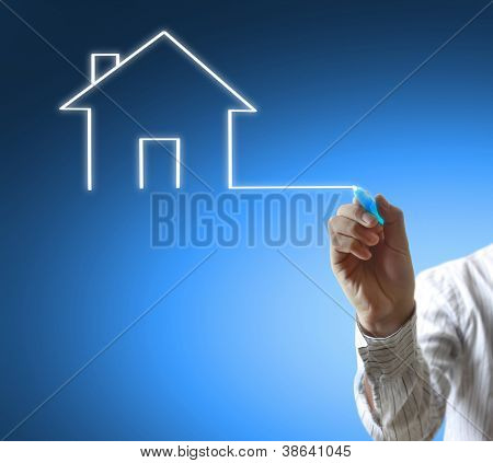Business man drawing house in a whiteboard