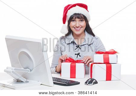 happy businesswoman in santa hat making christmas gifts. studio shot over white background