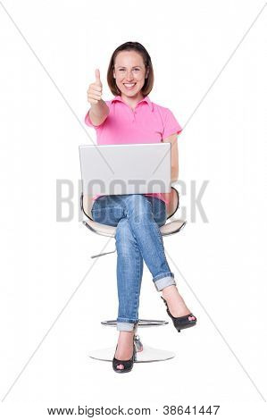 attractive and happy female showing thumbs up and holding laptop. over white background