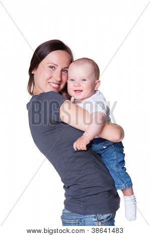cheerful young woman holding smiley little boy. isolated on white background