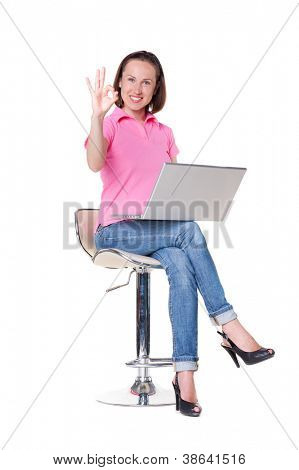 satisfied student holding laptop and showing ok symbol. isolated on white background