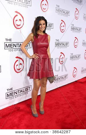 """LOS ANGELES - OCT 11:  Emmanuelle Chriqui arrives at """"The Mentalist"""" 100th Episode Party at The Edison on October 11, 2012 in Los Angeles, CA"""