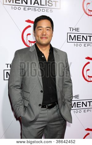"""LOS ANGELES - OCT 11:  TIm Kang arrives at """"The Mentalist"""" 100th Episode Party at The Edison on October 11, 2012 in Los Angeles, CA"""