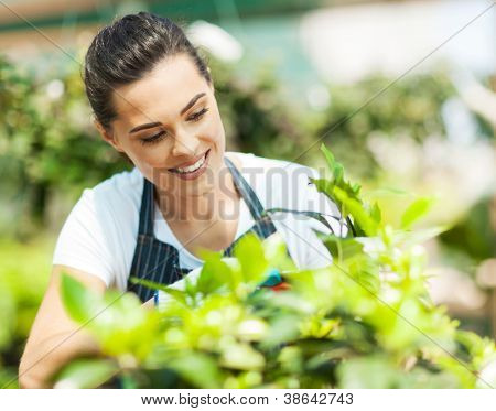 pretty young woman gardening