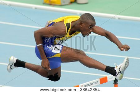 BARCELONA - JULY, 11: Tramaine Maloney of Barbados during 400m hurdles event of the 20th World Junior Athletics Championships at the Olympic Stadium on July 11, 2012 in Barcelona, Spain