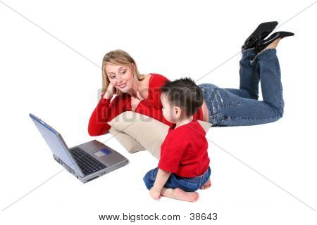 Adorable Family Moment With Mother And Son At The Laptop