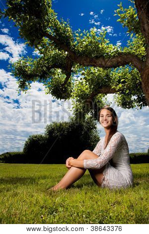 romantic scene of garden with girl and blue sky