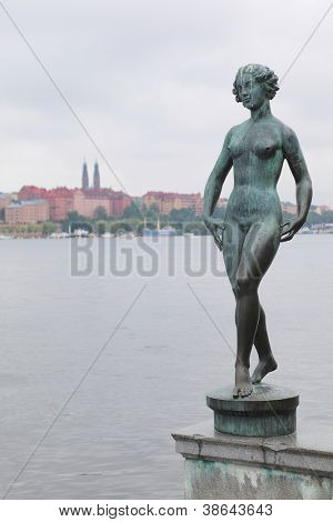 Statue at embankment near the City Hall in Stockholm, Sweden