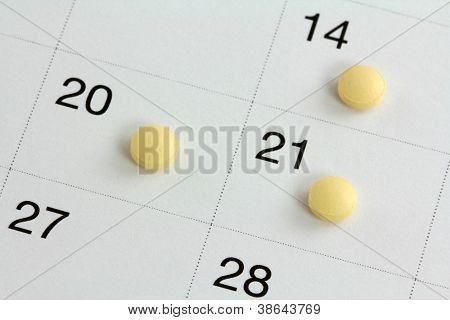 Monophasic Birth Control Pills : Oral Hormonal contraception tablet, on a calendar