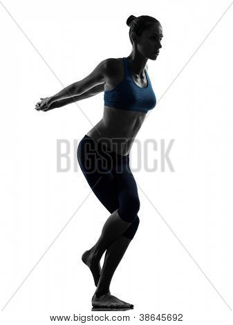 one caucasian woman exercising yoga yoga camel pose in silhouette studio isolated on white background