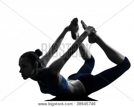one caucasian woman exercising yoga  bow pose in silhouette studio isolated on white background