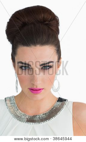Woman made up in a sixties mod style on white background