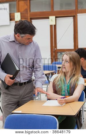Teacher is reassuring the student at the classroom