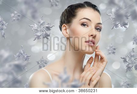 beautiful girl on the background of snow-flakes