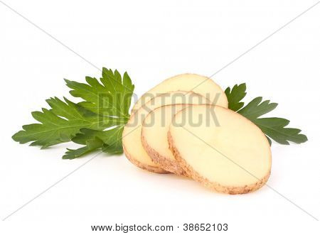 Sliced potato tubers and parsley leaves isolated on white background cutout