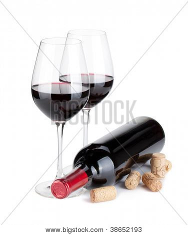 Red wine glasses, bottle and corks. Isolated on white background