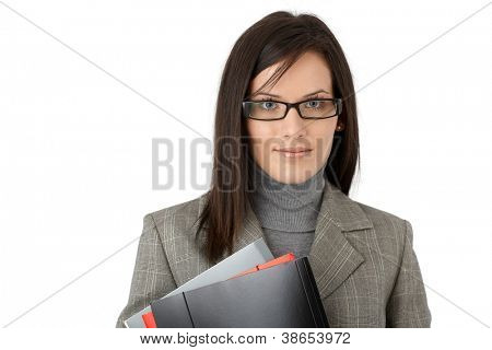 Business portrait of young confident woman with file folders.