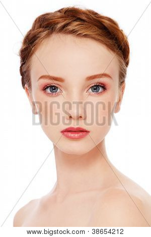 Portrait of young beautiful redhead freckled girl with fresh make-up, on white background
