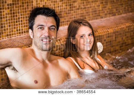 Portrait of a young couple relaxing in a spa
