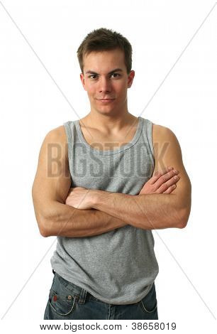 Young muscular man wearing a gray sleeveless shirt isolated on white