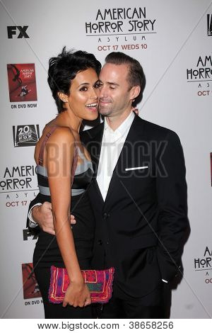 """LOS ANGELES - OCT 13:  Maria Dolores Dieguez, Joseph Fiennes arrives at the """"American Horror Story: Asylum"""" Premiere Screening at Paramount Theater on October 13, 2012 in Los Angeles, CA"""