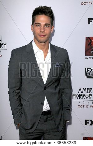 "LOS ANGELES - OCT 13:  Dean Geyer arrives at the ""American Horror Story: Asylum"" Premiere Screening at Paramount Theater on October 13, 2012 in Los Angeles, CA"