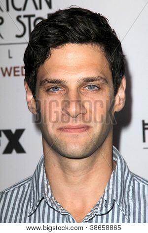 "LOS ANGELES - OCT 13:  Justin Bartha arrives at the ""American Horror Story: Asylum"" Premiere Screening at Paramount Theater on October 13, 2012 in Los Angeles, CA"