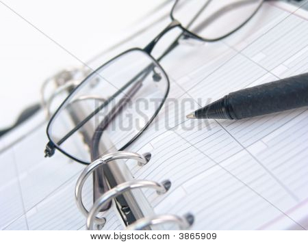 Planner, Pen And Glasses