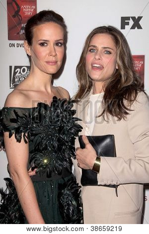"LOS ANGELES - OCT 13:  Sarah Paulson, Amanda Peet arrives at the ""American Horror Story: Asylum"" Premiere Screening at Paramount Theater on October 13, 2012 in Los Angeles, CA"