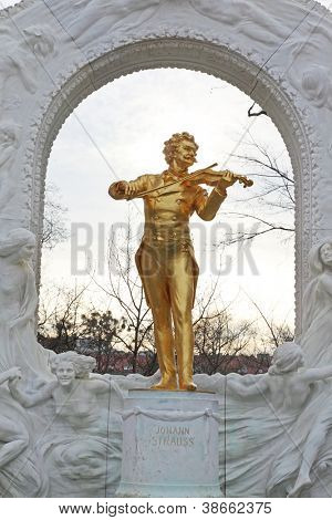 VIENNA- FEB 19: Johann Strauss statue on pedestal on FEB 19, 2012, in Vienna, Austria. First erected in 1921, Strauss monument is positioned in marble frame decorated with a relief by Edmund Hellmer.