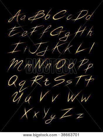 Alfabeto de estrellas brillantes oro polvo trail (brillante concepto de fuente)