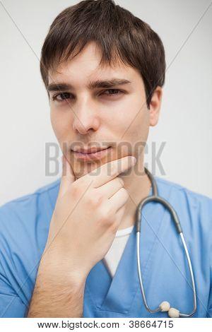 Nurse looking at the camera thinking close up
