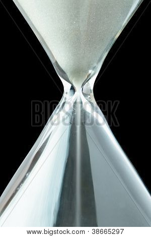 Close up of a hourglass against a black background