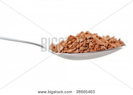 Spoon with chocolate powder against white background