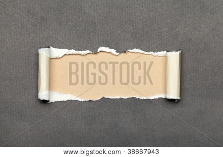 Torn grey paper with beige copyspace for your message