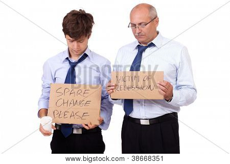 Two depressed businessmen in blue shirts holding a cardboard and asking about help after recession, isolated on white background