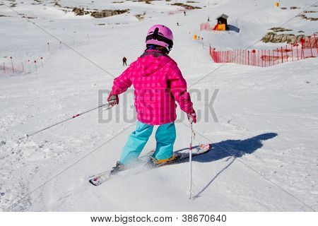 Skiing, winter, kid - skier on ski run, girl skiing downhill
