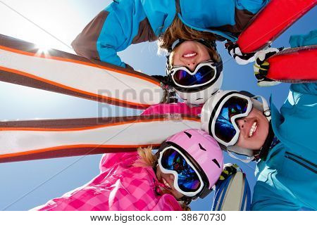 Skiing, winter fun - skiers enjoying ski holidays
