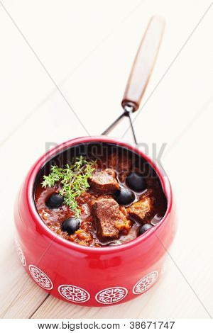 delicious goulash with black olives - food and drink /shallow DOFF/
