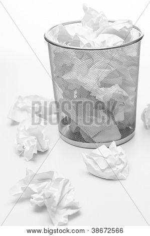 Office silver trash bin full of paper waste white isolated