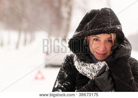 Woman with car breakdown snow accident road winter broken upset