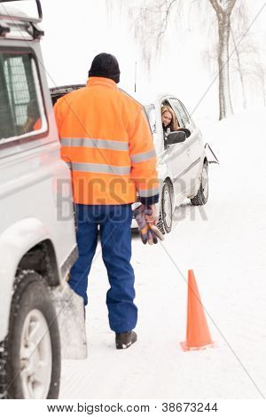 Man helping woman car breakdown assistance snow happy broken winter