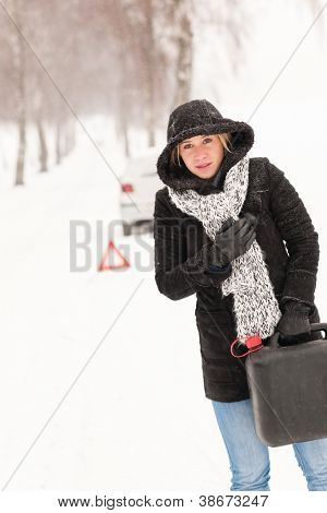 Woman holding gas can snow car breakdown winter help road