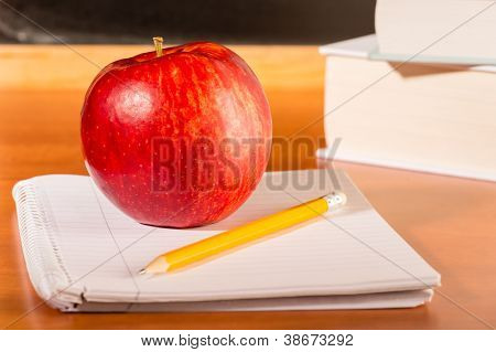 Academic education traditional student's desk apple, pencil and notepad